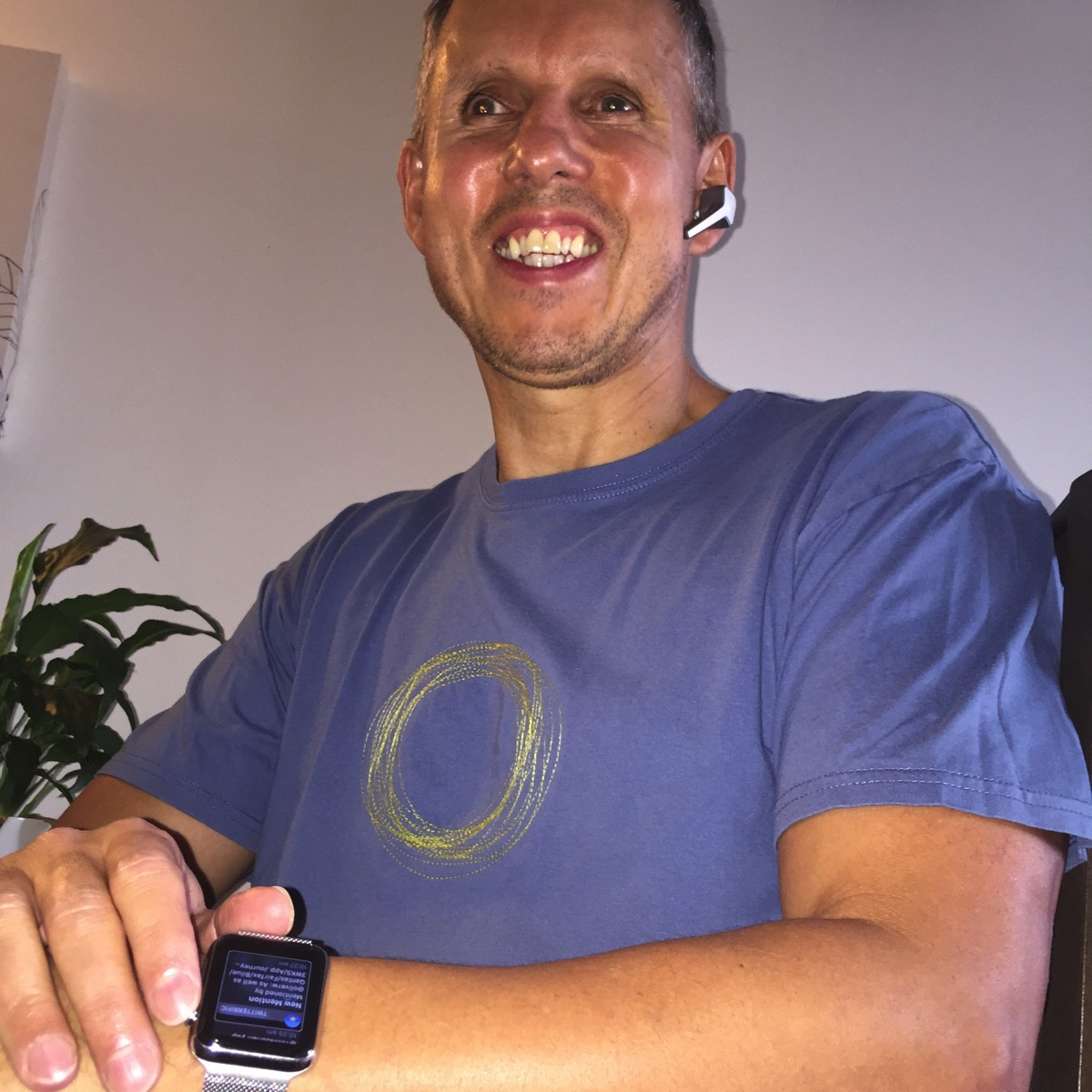 Tim with Apple Watch and Voyager Edge Earpiece