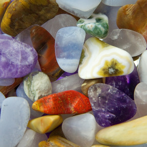 Orange, red, purple, frosted white, brown and yellow gemstones.