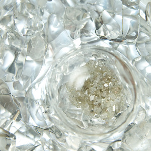 Diamonds slivers surrounded by clear gemstones.