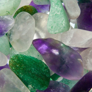 Purple, green and pink gemstones.