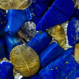 Blue gemstones and gold flecked clear gemstones.