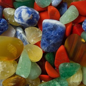 Red, blue, orange brown and green gemstones.